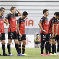 Grampus players line up after their defeat to Reysol at Toyota Stadium on Saturday. | KYODO