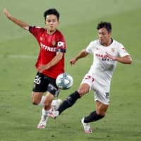 Mallorca's Takefusa Kubo (left), seen during a match against Sevilla in July, is moving to Villareal on a one-year loan from Real Madrid. | GETTY IMAGES / VIA KYODO