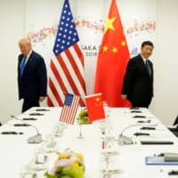 U.S. President Donald Trump attends a bilateral meeting with Chinese leader Xi Jinping during the Group of 20 leaders summit in Osaka in June last year. | REUTERS