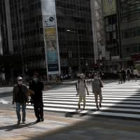 Although it's partly due to increased testing, Tokyo continues to see daily infections in the triple digits, with numbers going over 200 for 12 consecutive days. | BLOOMBERG