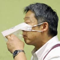Japanese restaurant chain operator Saizeriya Co. has 'developed' a face mask for use when eating and drinking, possibly a boon to eateries around the world hit hard by social distancing necessitated by the coronavirus. | KYODO