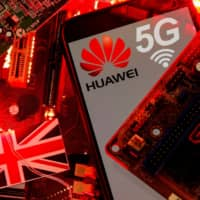 Huawei and 5G network logos are seen on a PC motherboard in this illustration picture.  | REUTERS