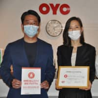 Oyo Hotel New Washington in Tokyo received certificates from Oyo Japan G.K. for passing sanitation benchmarks. This photo taken on July 27 shows Deputy-CEO Ryota Tanozaki (left), hotel owner Yoshimi Takahara (center) and a hotel employee. | KYODO