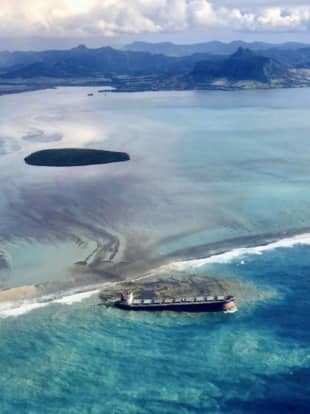 This photo of a Japanese-owned bulk carrier stranded on a reef off the coast of Mauritius was taken from Mauritius Prime Minister Pravind Jugnauth's official Twitter account. | KYODO