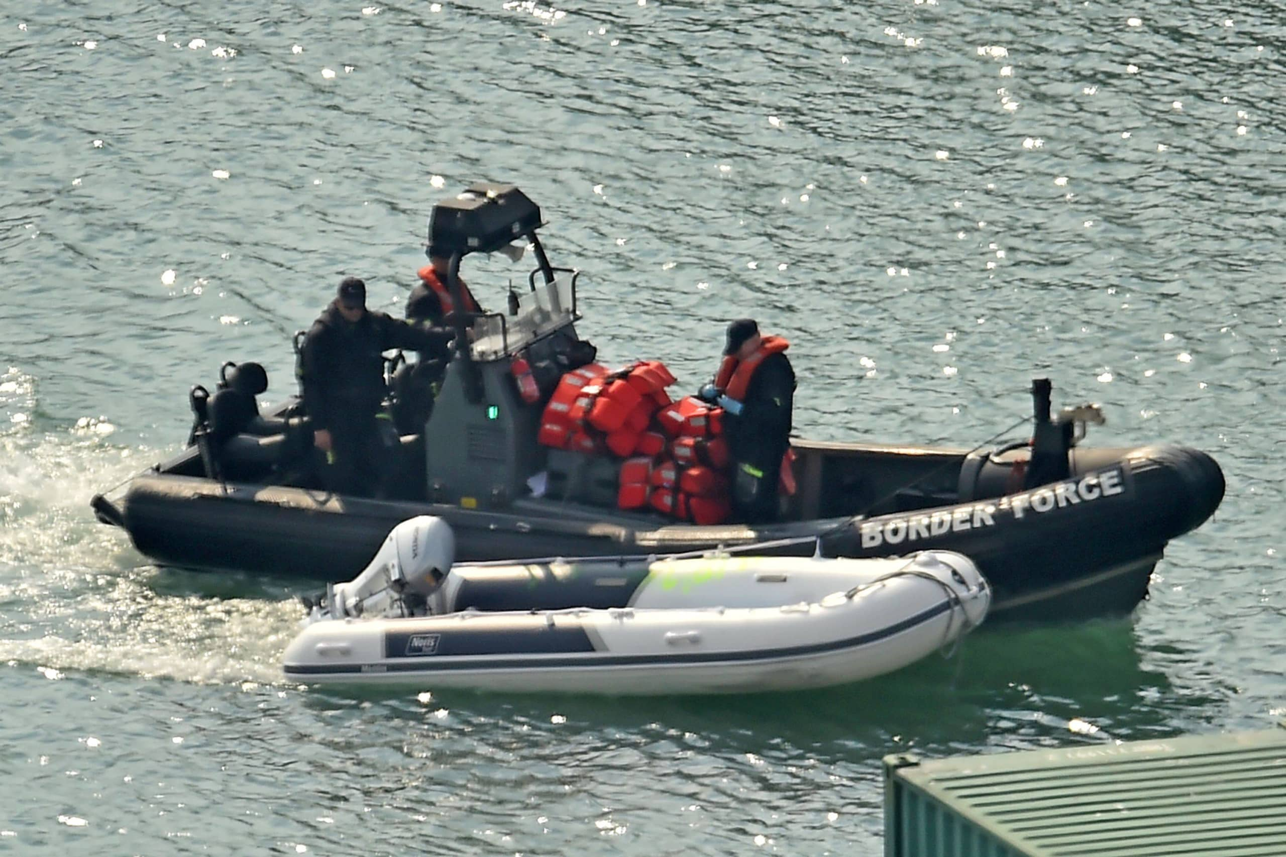 A dinghy and life-jackets, believed to have been taken from migrants picked up from boats in the Channel by U.K. Border Force officers, arrive in the port of Dover on the south-east coast of England on Sunday.    AFP-JIJI
