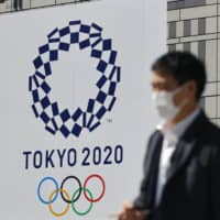 A recent survey shows over 60 percent of volunteers registered for next summer's Tokyo Olympic and Paralympic Games are worried about how anti-coronavirus measures will be implemented. | KYODO