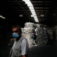 Stacks of plastics are stored for distribution to recycling companies at the Amarsul plant in Seixal, Portugal, on July 7. | REUTERS