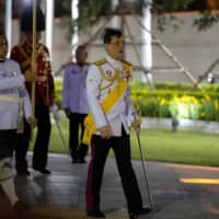 Thailand's King Maha Vajiralongkorn arrives to pay his respects at the King Rama I monument in Bangkok on April 6 to honor the start of the Chakri dynasty's reign. | REUTERS