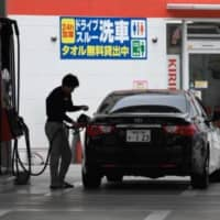 As the coronavirus pandemic forces people to avoid long-distance travel, gas stations in tourist areas in Japan are having a tough time. | BLOOMBERG