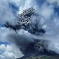 Mount Sinabung spews volcanic ash in Karo, North Sumatra province, Indonesia, on Monday.  | ANTARA FOTO / VIA REUTERS