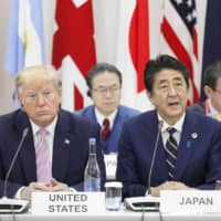 The 'new Cold War' developing between the United States under President Donald Trump and China under President Xi Jinping is presenting problems for Prime Minister Shinzo Abe regarding alliances and security. | KYODO