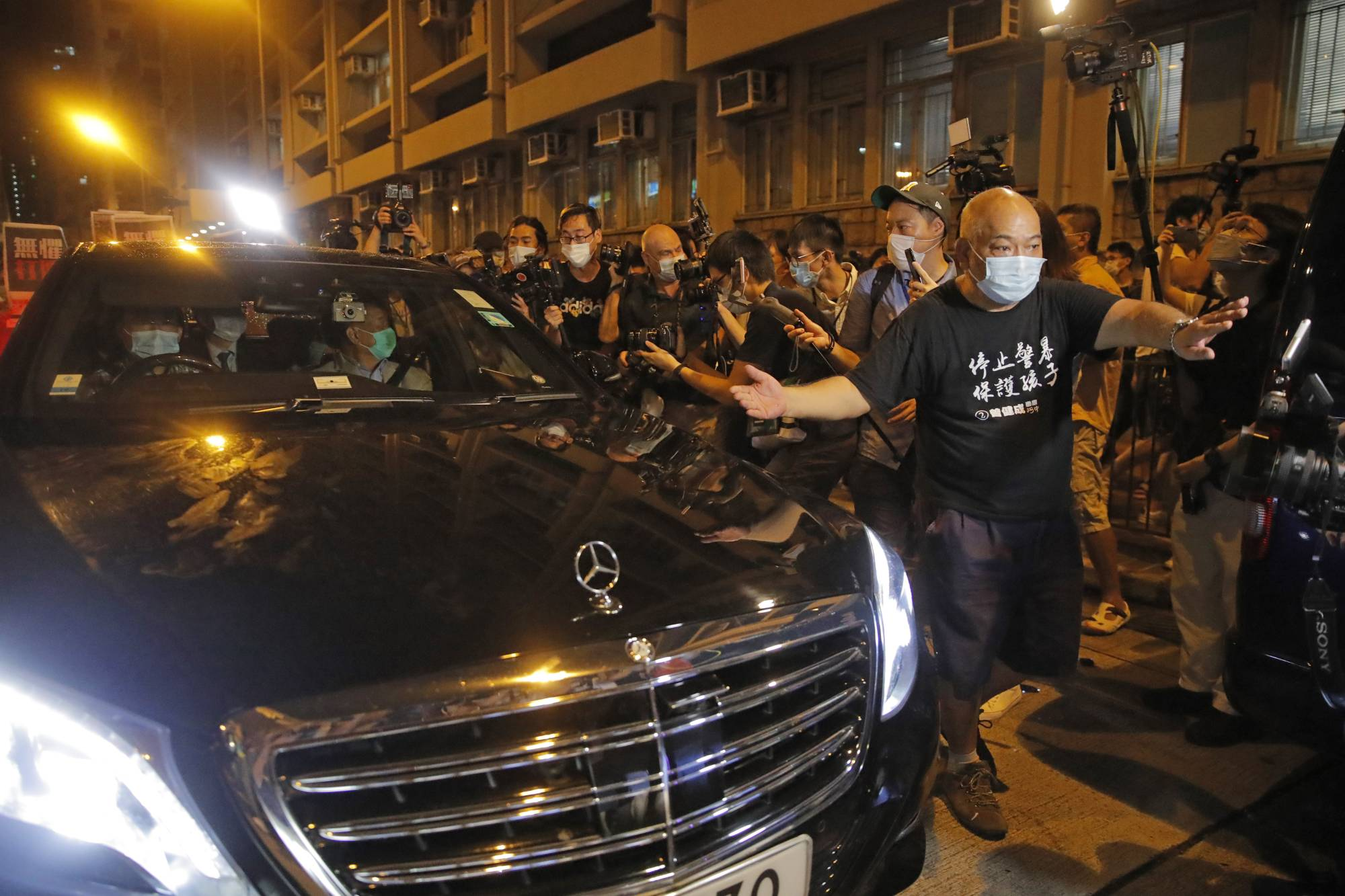 Jimmy Lai sits in a car as he leaves a police station after being bailed out in Hong Kong on Wednesday. | AP