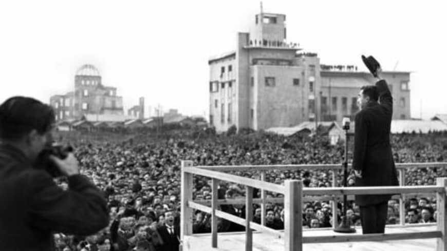 Emperor Hirohito responds to citizens in Hiroshima on Dec. 7, 1947, on one of his visits to places around the nation after the end of World War II.