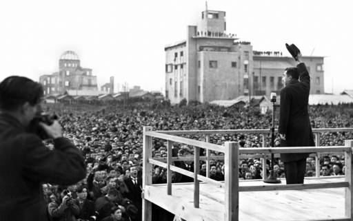 Emperor Hirohito responds to citizens in Hiroshima on Dec. 7, 1947, on one of his visits to places around the nation after the end of World War II. | KYODO