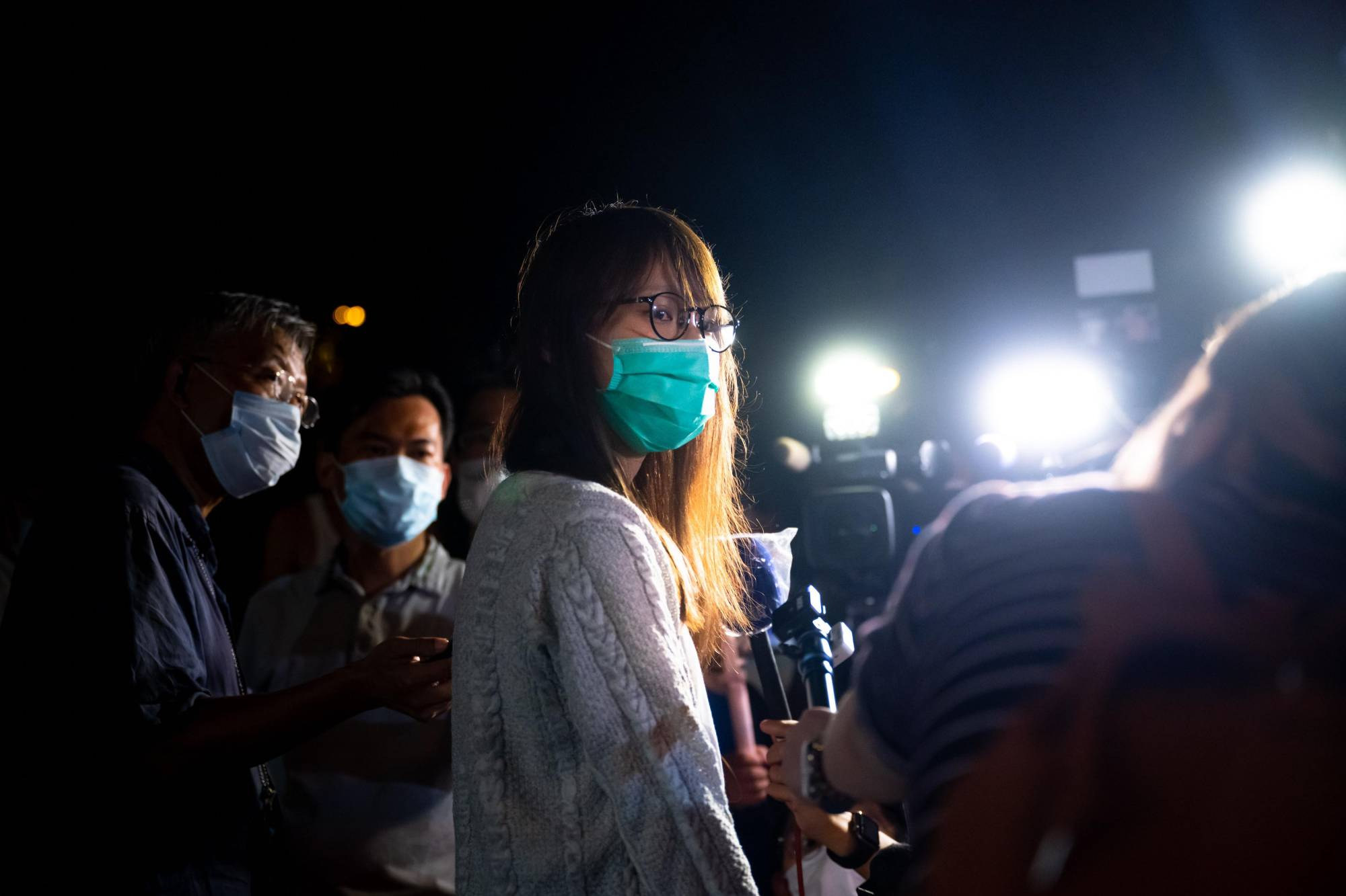 Agnes Chow speaks to reporters Tuesday in Hong Kong after she was released on bail.   GETTY IMAGES / VIA KYODO
