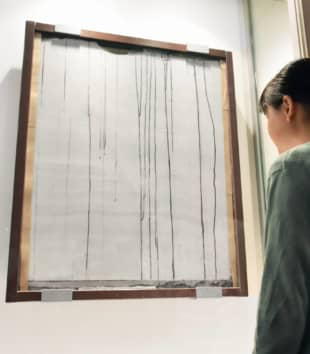A white wall with streaks of black rain is displayed in Hiroshima Peace Memorial Museum. | KYODO