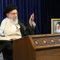 Iranian leader Ayatollah Ali Khamenei delivers a televised speech last month in Tehran, during which he said that negotiating with Washington over his country's nuclear program would only help get U.S. President Trump re-elected. | OFFICE OF THE IRANIAN SUPREME LEADER / VIA THE NEW YORK TIMES