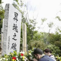Bereaved family members of the victims of the 1985 Japan Airlines jetliner crash offer prayers at the site where the airliner went down in Ueno, Gunma Prefecture, on Wednesday, the 35th anniversary of the accident that killed 520 passengers and crew. | KYODO