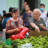 China's recovery threatened by surging prices and stagnant wages