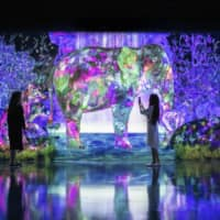 Wild fun: Visitors can learn about the multicolored animals in 'Catching and Collecting Forest' by shooting arrows at them using a smartphone app. Once an animal is hit, it appears in the app with details about its real-life inspiration. | COURTESY OF TEAMLAB