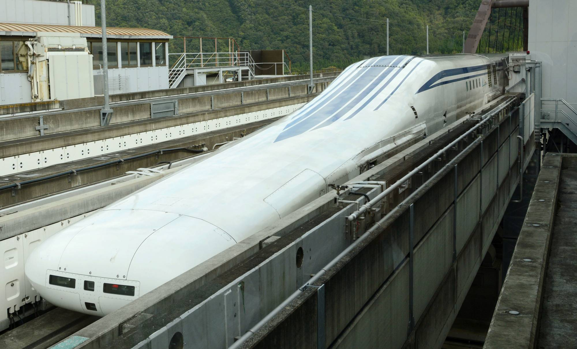 A prototype of a Central Japan Railway Co. maglev train is unveiled to the media at an experimental center in Yamanashi Prefecture on Oct. 3, 2019. | KYODO