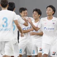 Sagan players celebrate after beating FC Tokyo on Aug. 1. | KYODO