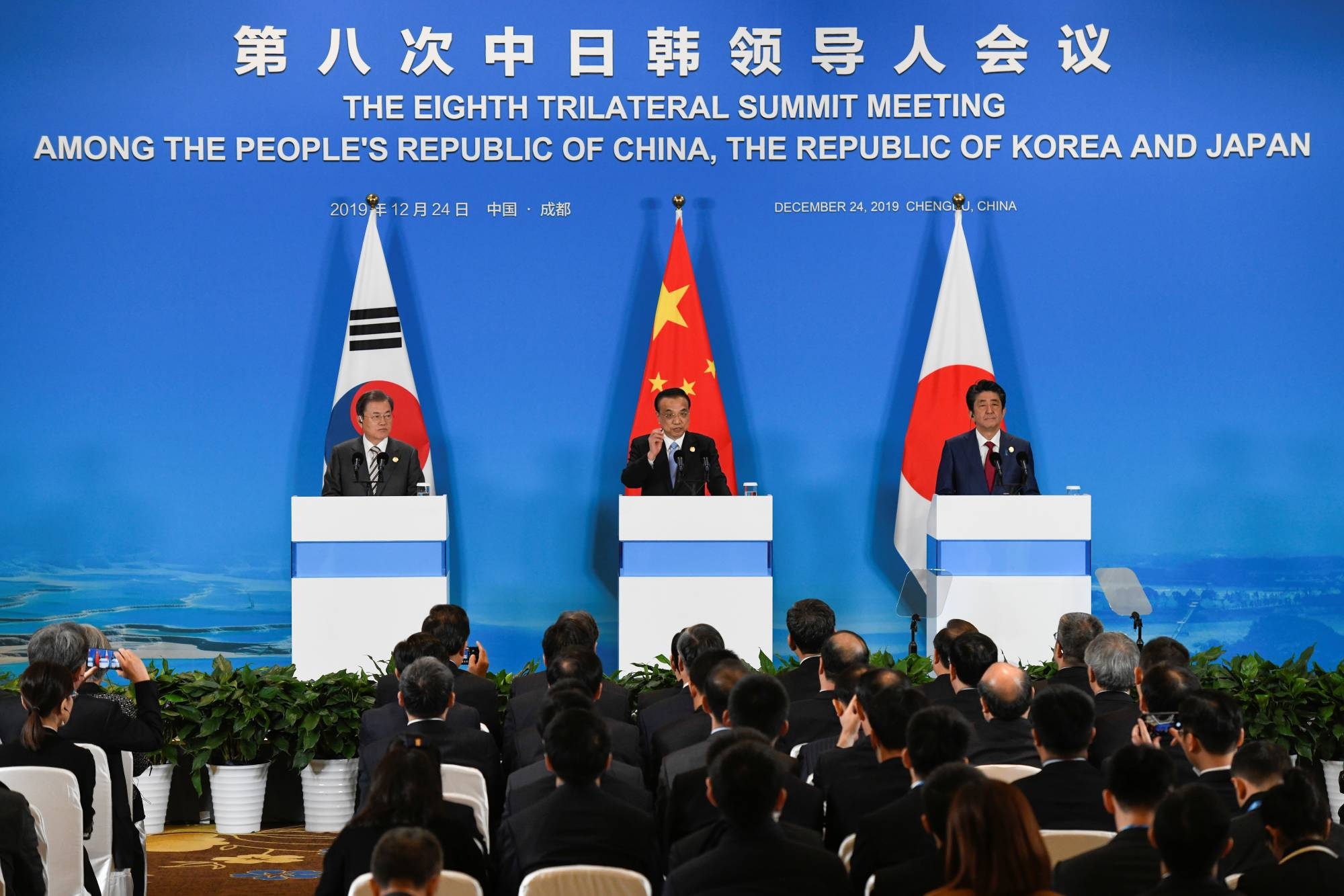 Prime Minister Shinzo Abe, Chinese Premier Li Keqiang and South Korean President Moon Jae-in meet at the Eighth Trilateral Summit on Dec. 24. More venues, forums and platforms are needed for Japanese, South Koreans and Chinese to reconcile their differences. | REUTERS