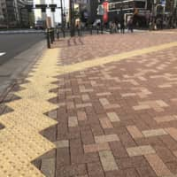Tactile paving at an intersection in Tokyo.  | KATHRYN WORTLEY