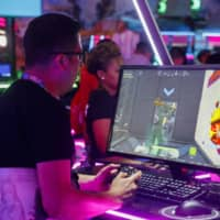 An attendee plays Fortnite during the E3 Electronic Entertainment Expo in Los Angeles in June 2019. | BLOOMBERG