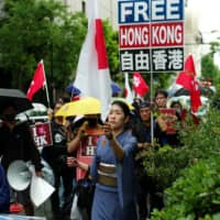 Protesters called on the Hong Kong government to shelve a controversial extradition bill during a demonstration in Shibuya Ward, Tokyo, in June last year. The bill was later abandoned following mass protests. | RYUSEI TAKAHASHI