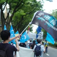 More than 300 protesters marched through the streets of Shibuya Ward, Tokyo, in July to speak out against China's national security law. | RYUSEI TAKAHASHI
