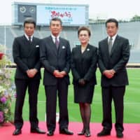Tetsuya Watari (second from left) poses during an event in Tokyo in May 2009. | KYODO
