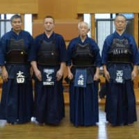 Teamwork: (Named from left to right) Shigeru Ohta, Alexander Bennett, Kazuo Odachi and Hiroyoshi Nishijima met through their passion for kendo and worked together to publish Japanese and English versions of Odachi's memoir.  | COURTESY OF KAZUO ODACHI