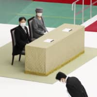 Prime Minister Shinzo Abe bows after speaking at the Memorial Ceremony for the War Dead at Nippon Budokan in Tokyo on Saturday, as Emperor Naruhito and Empress Masako look on. | KYODO