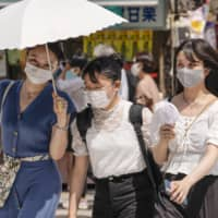 Tokyo's daily infection figure has stayed below 400 during the Bon holidays, after hitting a record 472 cases on Aug. 1, but the figures are up sharply from around 200 daily cases posted between Monday and Thursday. | KYODO