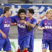 FC Tokyo's Leandro (second from left) celebrates his goal against Nagoya with teammates Ryoya Ogawa (left), Sei Muroya (second from right) and Shuto Abe on Saturday at Ajinomoto Stadium. | KYODO