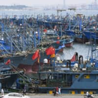 Chinese fishing boats wait to depart a port in Shishi, in China's Fujian province, on Saturday. | KYODO
