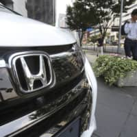 Japanese officials tried to push Nissan-Honda merger talks, report says