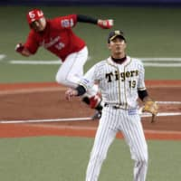 The Tigers' Shintaro Fujinami allowed six runs over six innings against the Carp on Wednesday in Osaka. | KYODO
