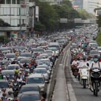 The streets of Hanoi are clogged during the morning rush hour after Vietnam eased its nationwide lockdown for the coronavirus pandemic on May 25. | REUTERS