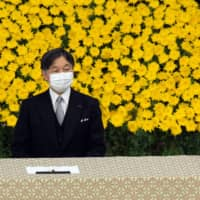 Emperor Naruhito and Empress Masako attend a memorial service marking the 75th anniversary of Japan's surrender in World War II at the Nippon Budokan hall on Aug. 15. | POOL / VIA REUTERS