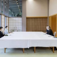 Emperor Naruhito and Empress Masako hear from business leaders on July 27. | COURTESY OF THE IMPERIAL HOUSEHOLD AGENCY / VIA KYODO