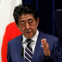 Prime Minister Shinzo Abe's economic legacy is under threat from the coronavirus pandemic, which has led to the nation's worst postwar economic slump. | REUTERS