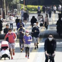 People enjoy Komazawa Olympic Park in Tokyo in April. | KYODO