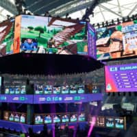Contestants compete during the Fortnite World Cup Duos Finals at Flushing Meadows Arthur Ashe stadium in the Queens borough of New York in July 2019. | REUTERS
