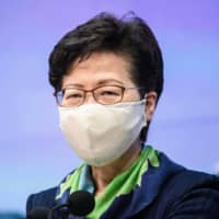 Carrie Lam says the U.S. sanctions have brought her some trouble when using credit cards, but described the experience as 'meaningless.' | AFP-JIJI