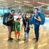 On the move: The Nguyen-Van Riper family owns little and packs lightly when traveling, as seen in this photo taken in Changi Airport in Singapore in October. | COURTESY OF LIEZL VAN RIPER; KYODO