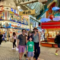 Kansai class: The Nyugen-Van Riper family, who are worldschooling their two children, tried new foods in Nakaza Kuidaore in Osaka in June. | COURTESY OF LIEZL VAN RIPER; KYODO