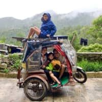 Feels on wheels: The Nguyen-Van Riper family rode a tricycle for three days to explore the famous Banaue Rice Terraces of the Philippines in November. | COURTESY OF LIEZL VAN RIPER; KYODO