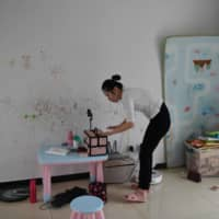 Former massage therapist Xiao Jia prepares for an online makeup class she teaches for blind people at her home in Beijing. | AFP-JIJI